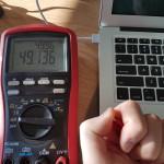 50V AC when touching charging Macbook